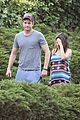 mila kunis hides her baby bump in loose fitting dress 18