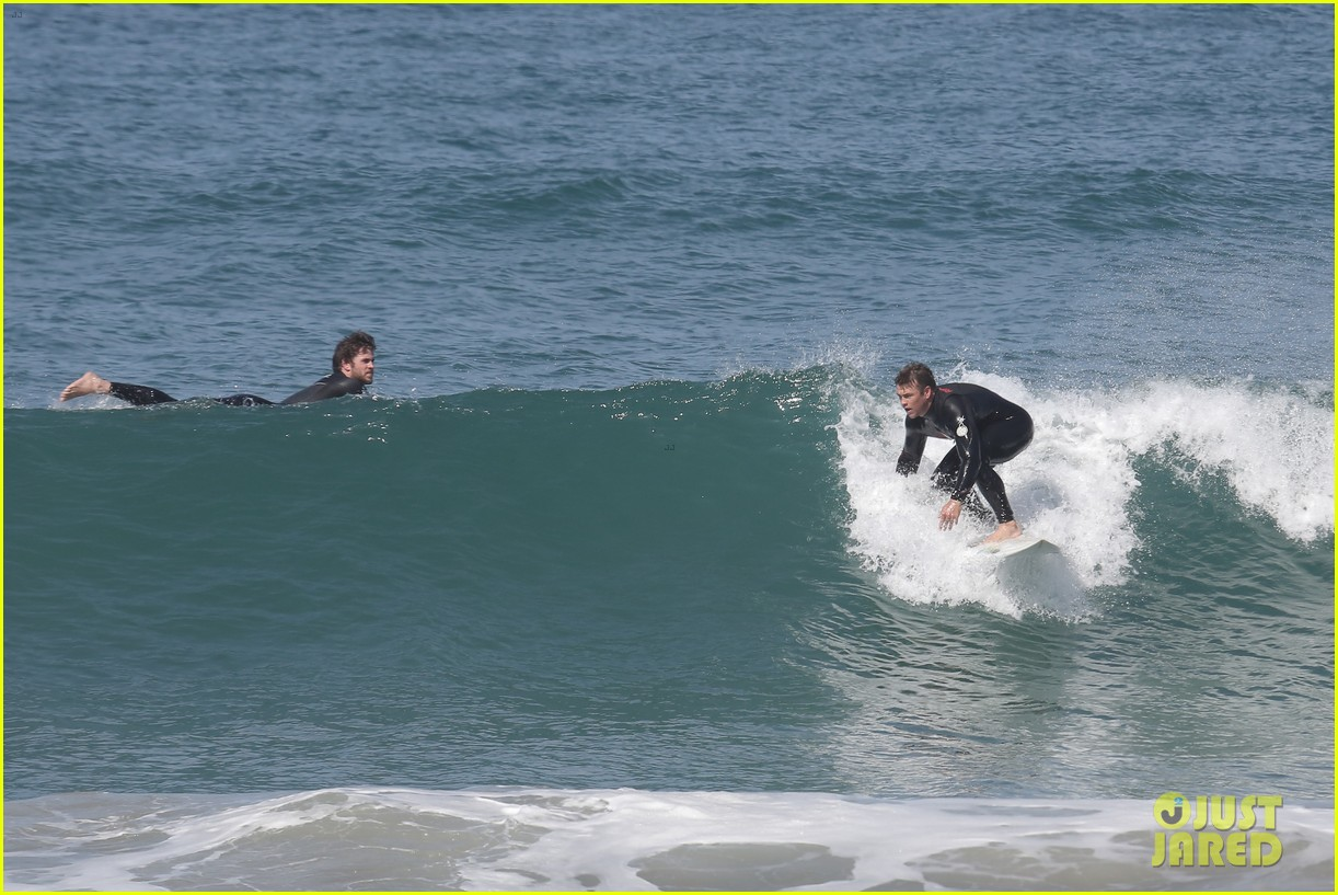 liam hemsworth hits waves malibu brother luke 103105146