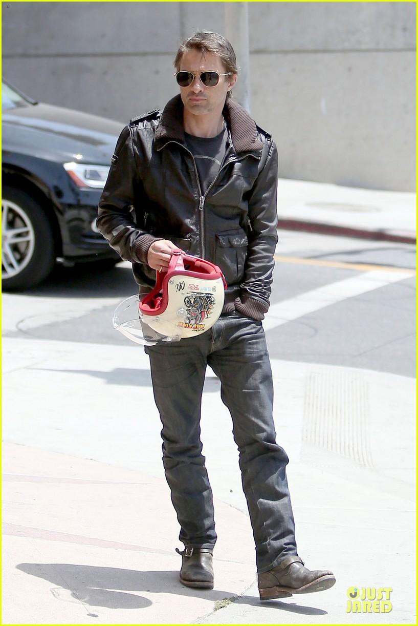 olivier martinez carrys motorcycle purse like a purse 153118675