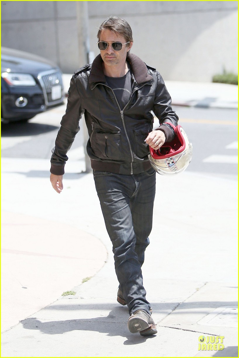 olivier martinez carrys motorcycle purse like a purse 243118684