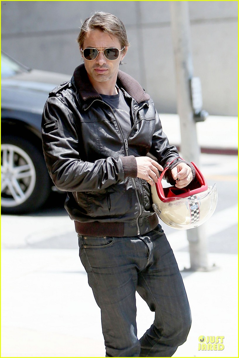 olivier martinez carrys motorcycle purse like a purse 263118686