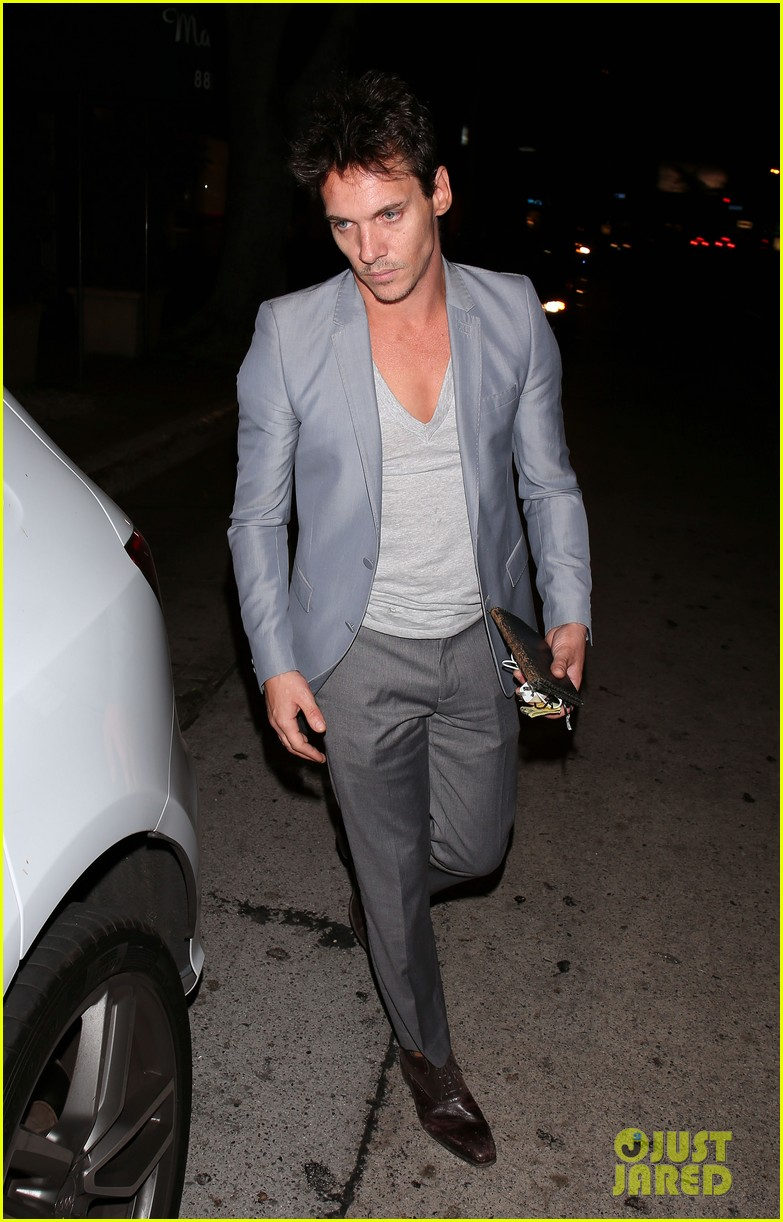 jonathan rhys meyers wears a deep v neck t shirt displays some chest 113107690