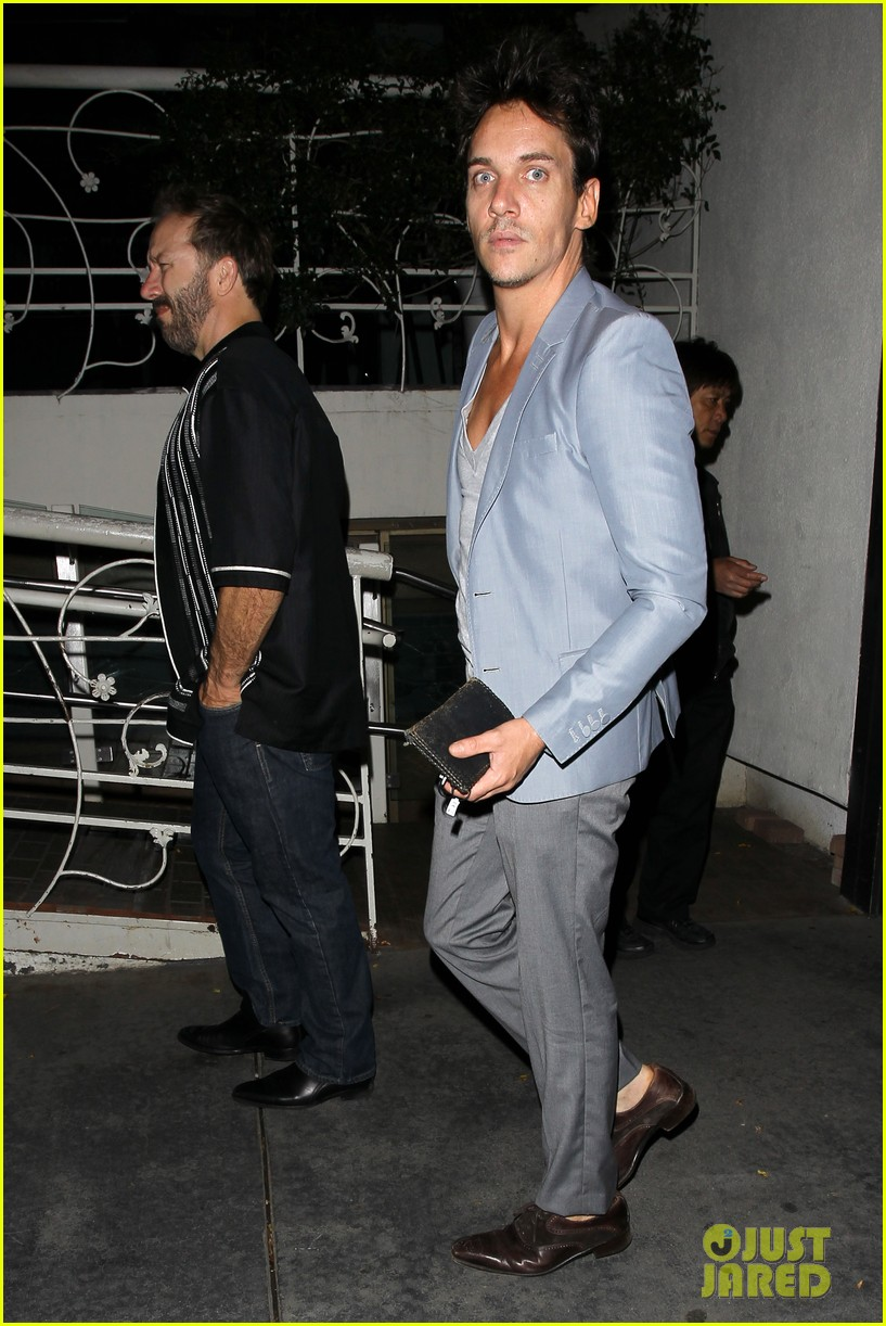 jonathan rhys meyers wears a deep v neck t shirt displays some chest 153107694