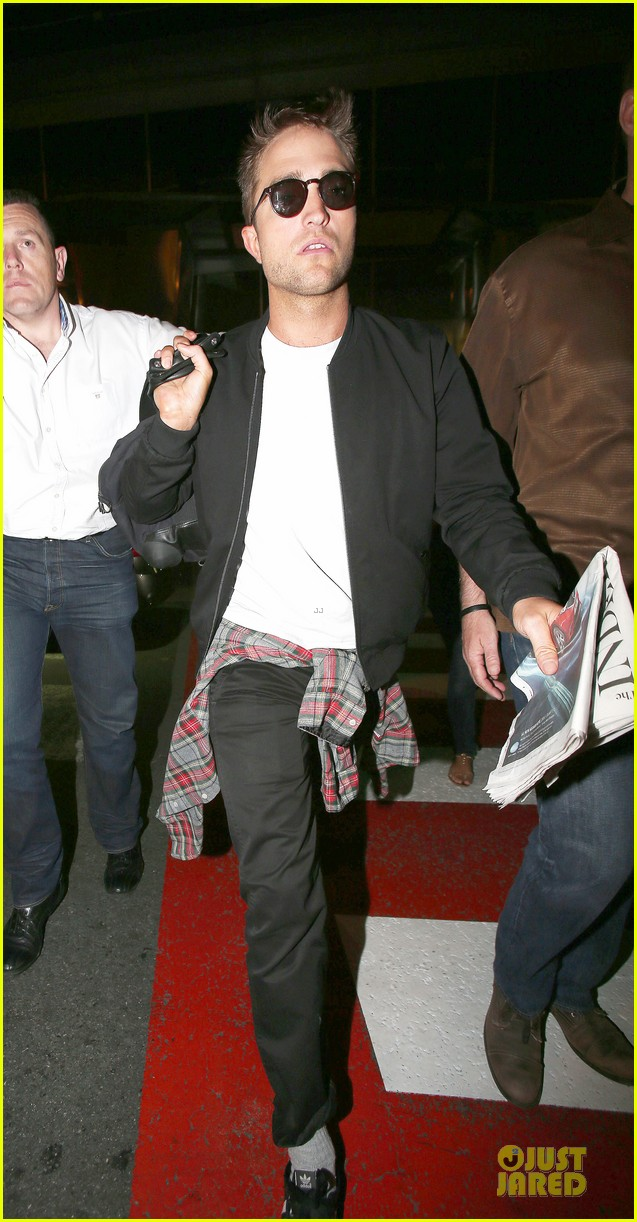 robert pattinson flies to nice for cannes 12