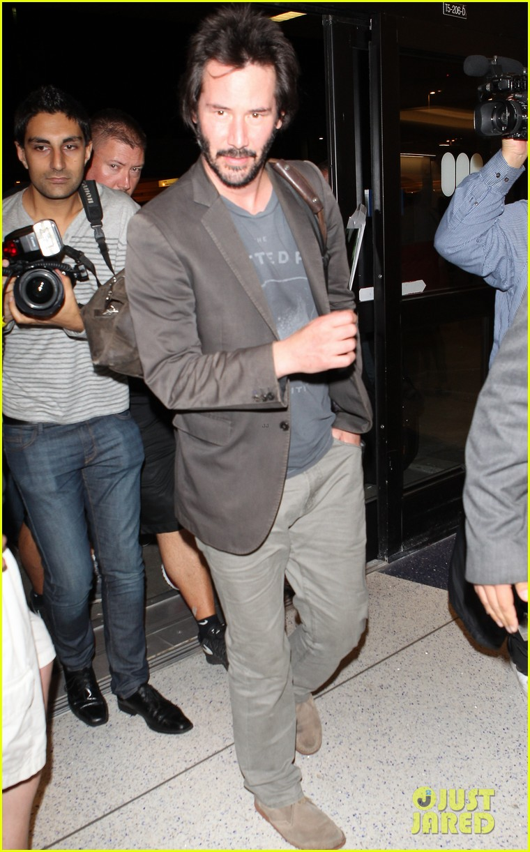 keanu reeves gets swarmed by fans at lax airport 053125026