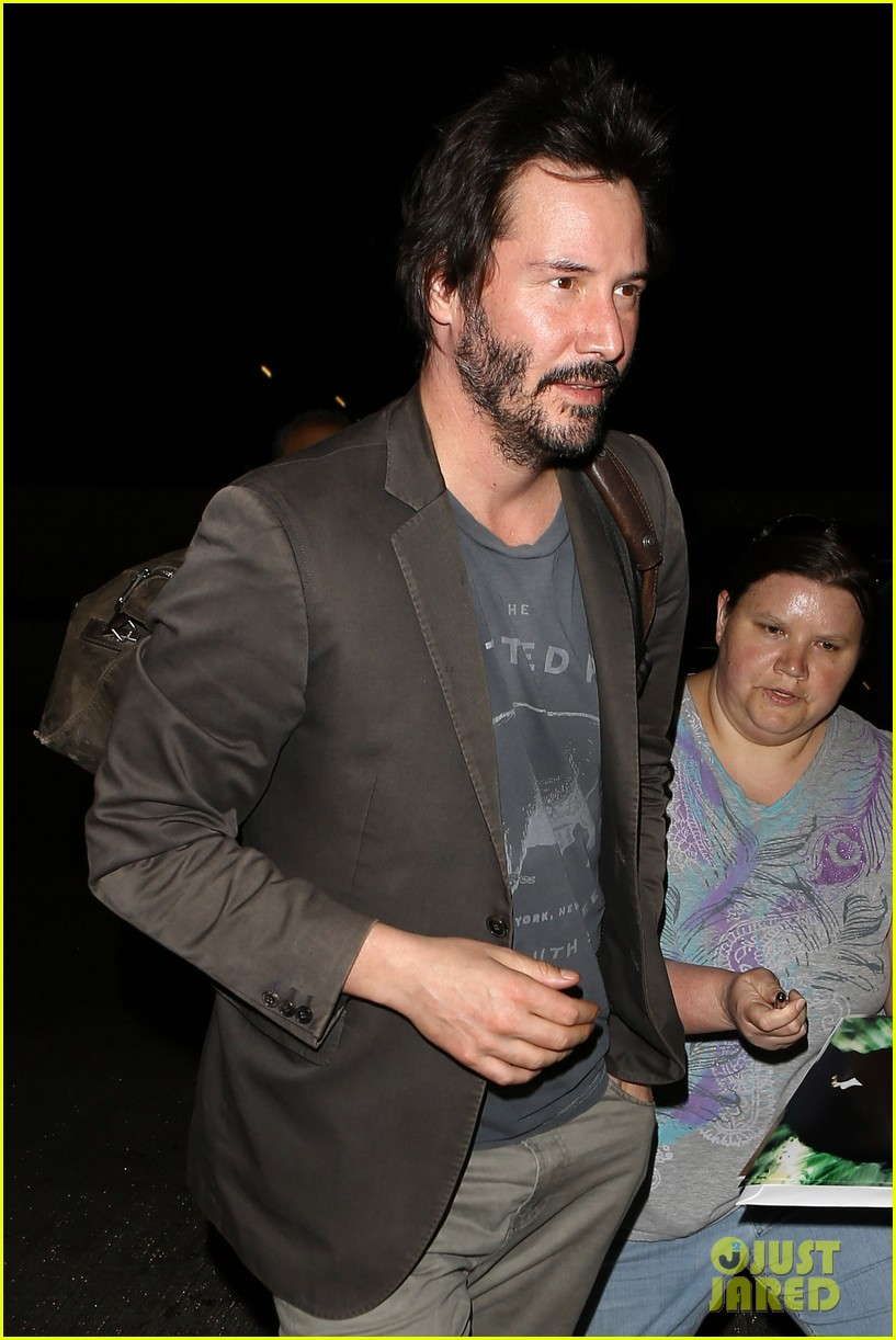 keanu reeves gets swarmed by fans at lax airport 083125029