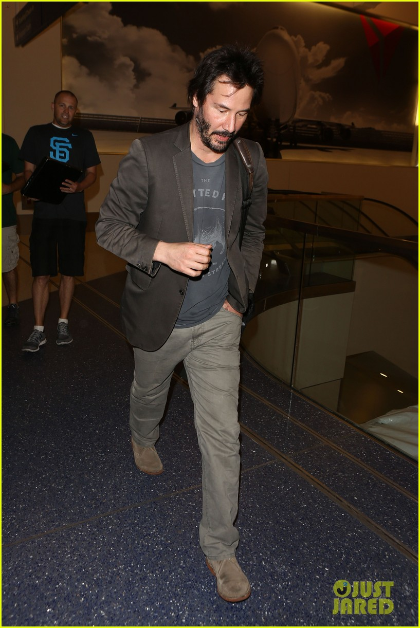 keanu reeves gets swarmed by fans at lax airport 123125033