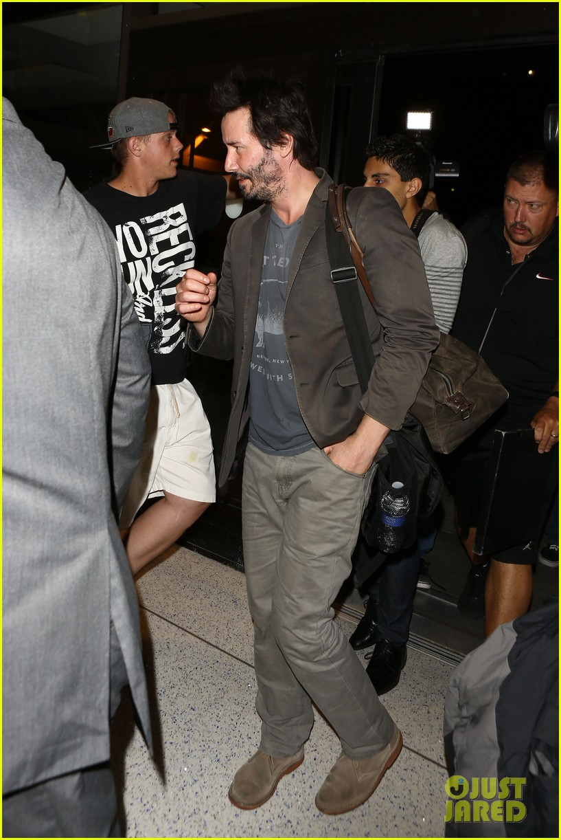 keanu reeves gets swarmed by fans at lax airport 133125034