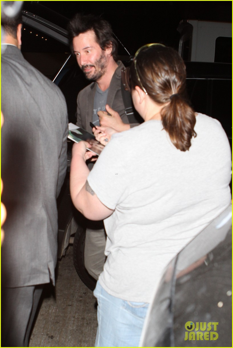 keanu reeves gets swarmed by fans at lax airport 163125037