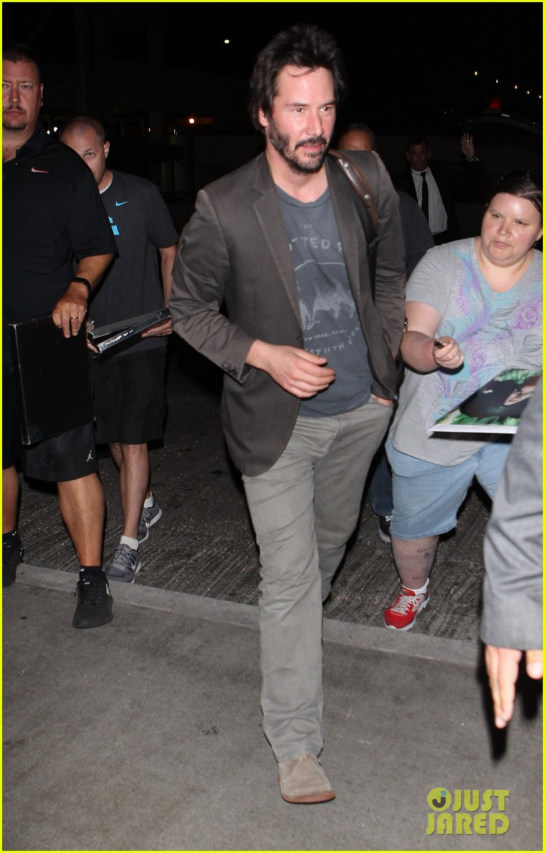 keanu reeves gets swarmed by fans at lax airport 193125040