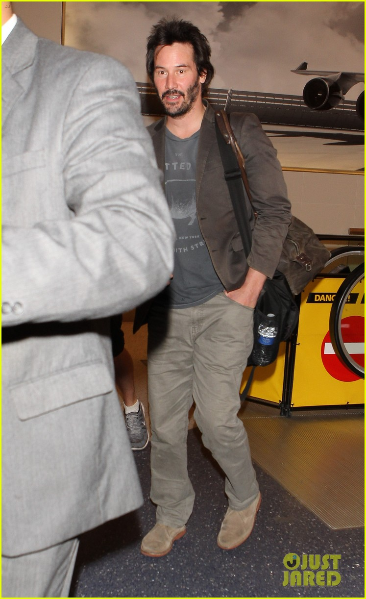 keanu reeves gets swarmed by fans at lax airport 223125043