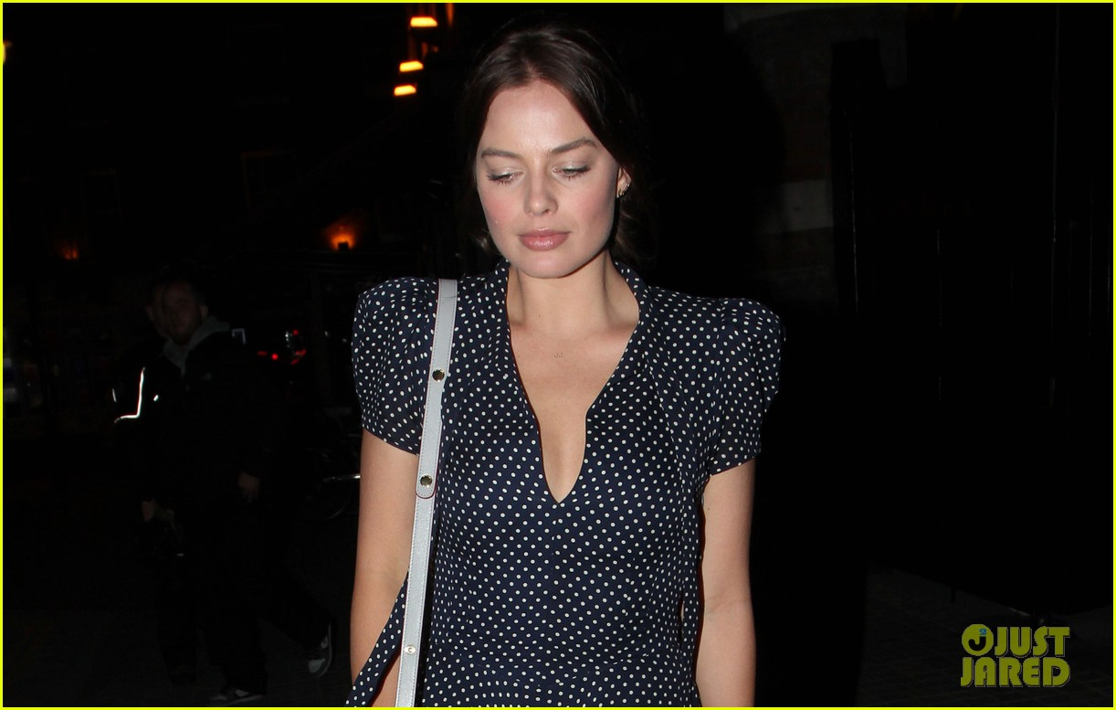 margot robbie pairs her polka dot dress with cute lace up shoes 023114990