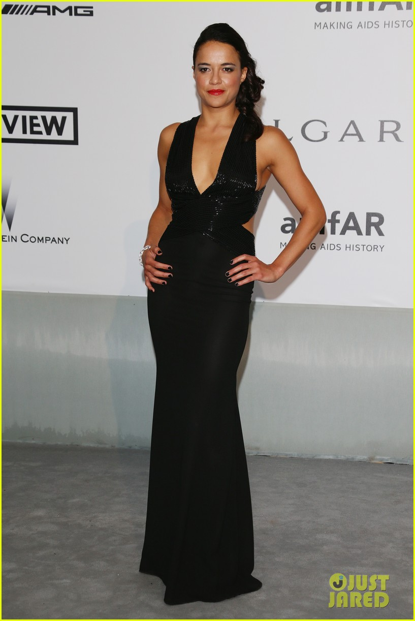 michelle rodriguez milla jovovich keep it chic at cannes amfar gala 12