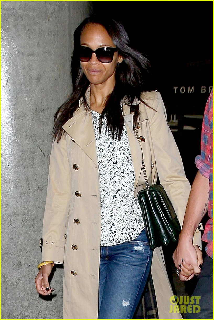 zoe saldana hubby marco perego return to l a after cannes 09