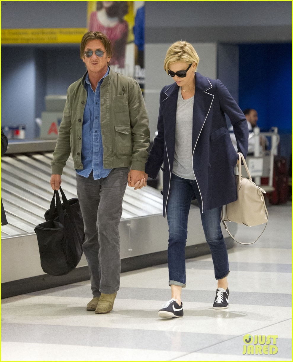 charlize theron sean penn hold hands upon new york arrival 05