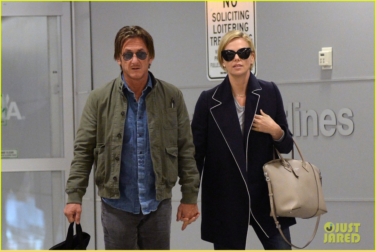 charlize theron sean penn hold hands upon new york arrival 093105563