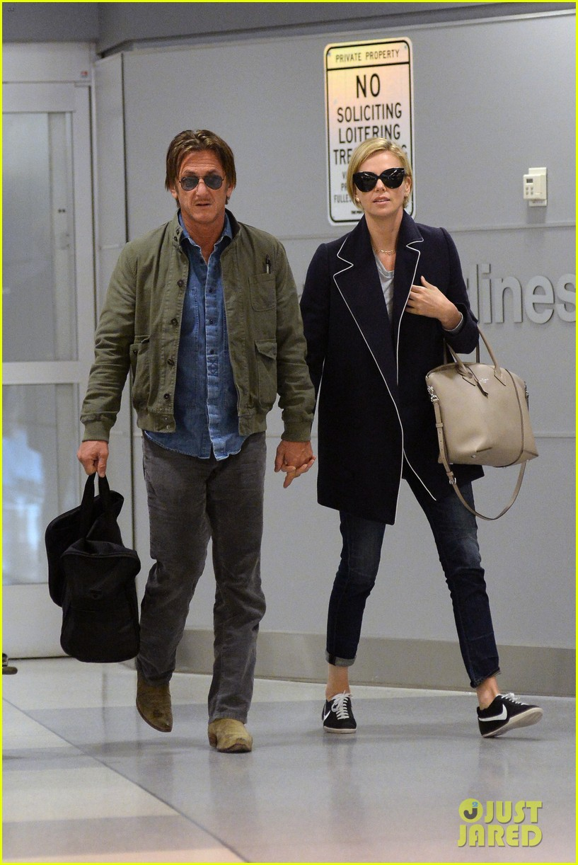 charlize theron sean penn hold hands upon new york arrival 103105564