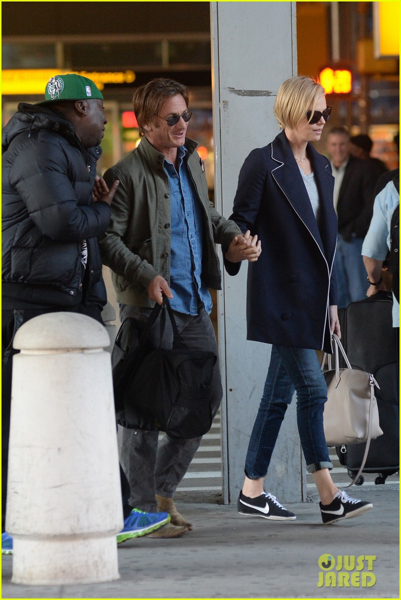 charlize theron sean penn hold hands upon new york arrival 143105568