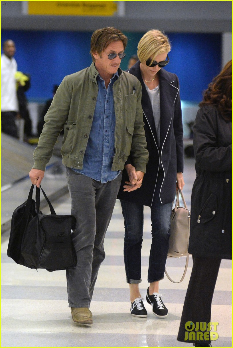 charlize theron sean penn hold hands upon new york arrival 213105575