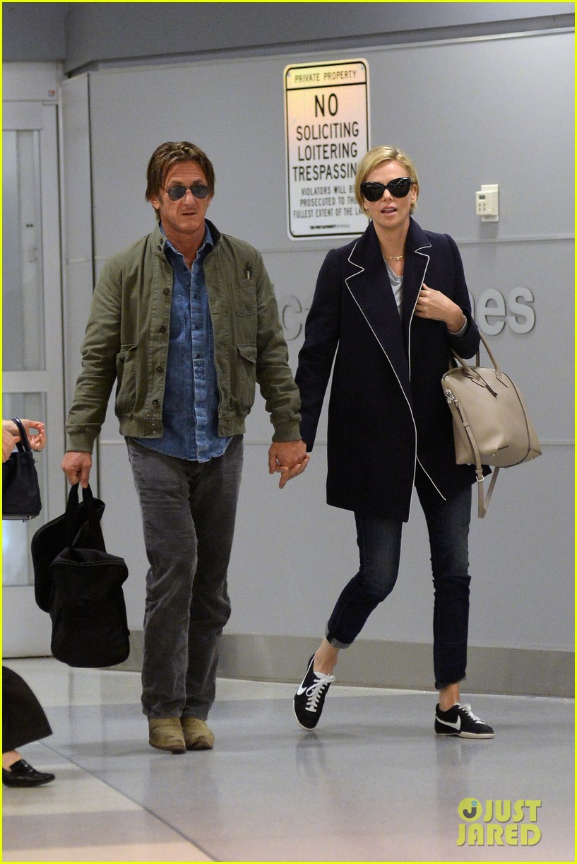 charlize theron sean penn hold hands upon new york arrival 223105576