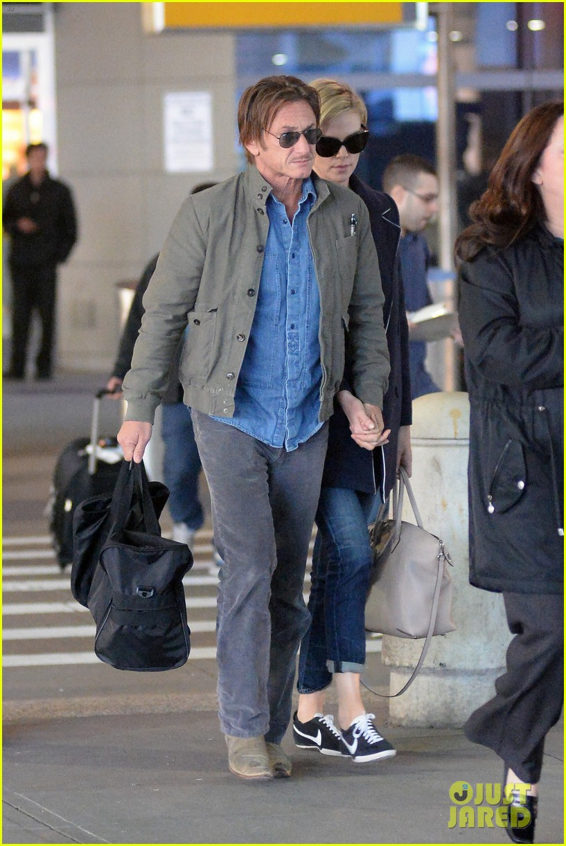 charlize theron sean penn hold hands upon new york arrival 233105577