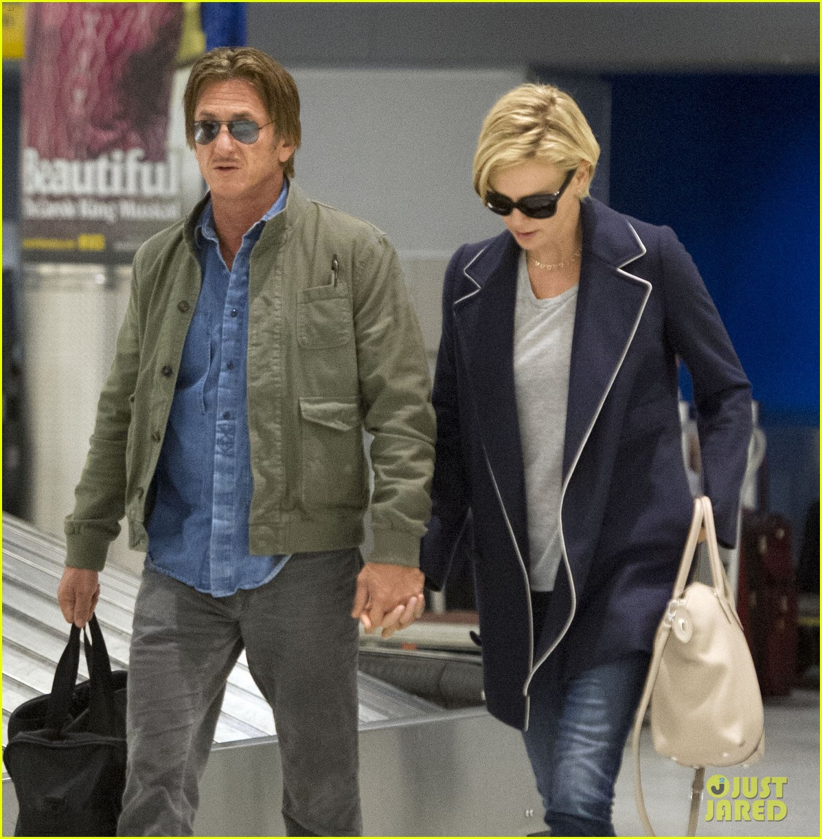charlize theron sean penn hold hands upon new york arrival 263105580