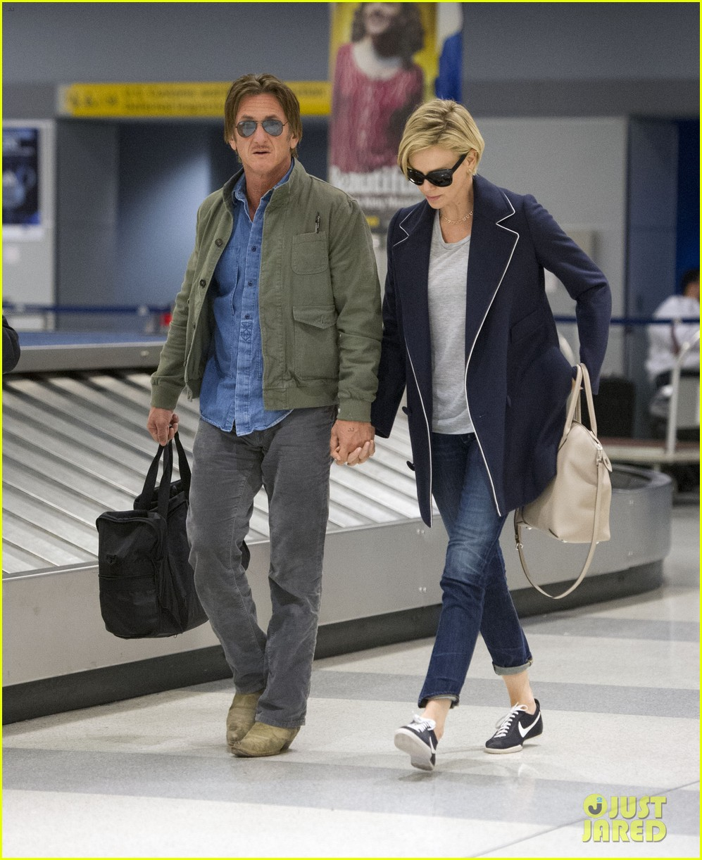charlize theron sean penn hold hands upon new york arrival 273105581