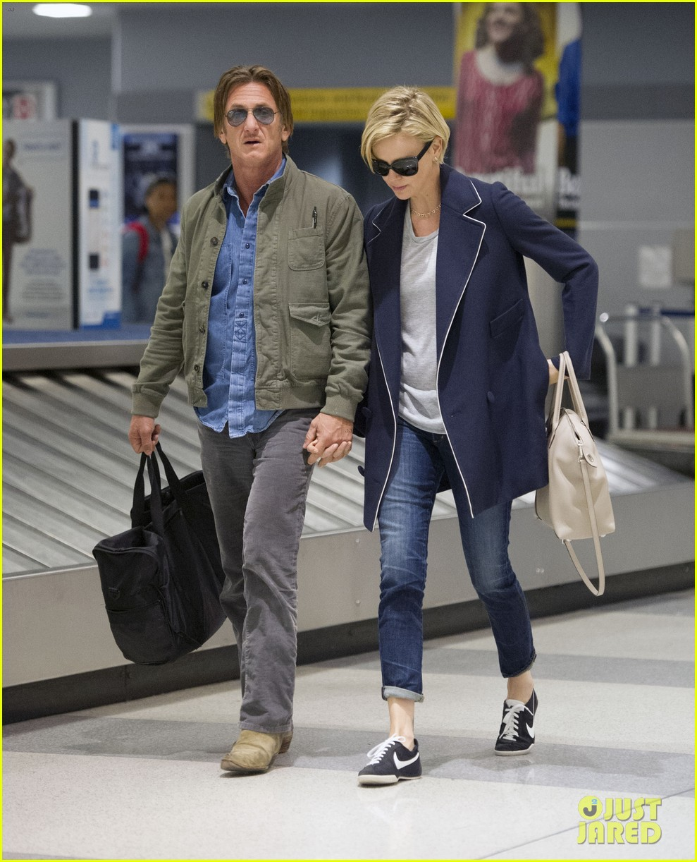 charlize theron sean penn hold hands upon new york arrival 323105586