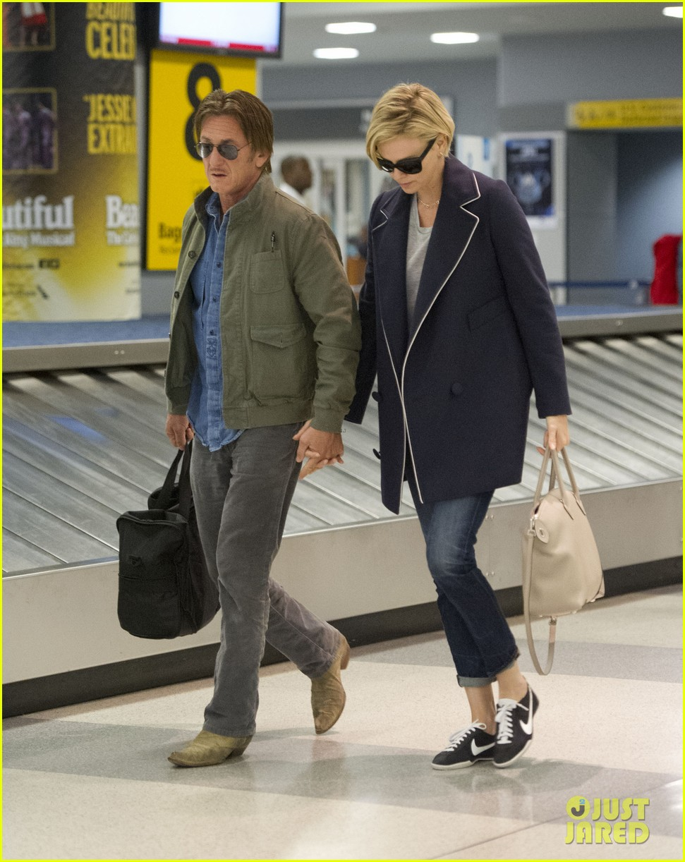 charlize theron sean penn hold hands upon new york arrival 333105587