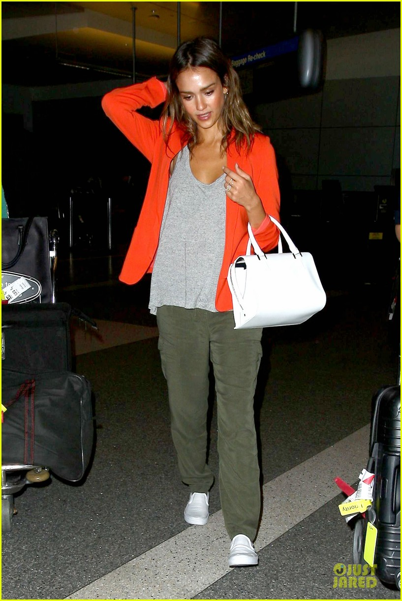 jessica alba red hot arrival at lax airport 12