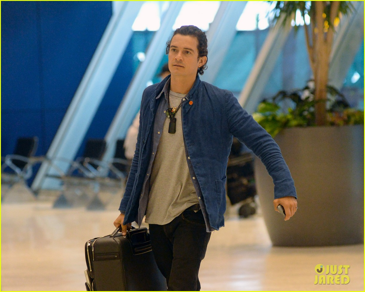 orlando bloom jets off after getting lap dance neil patrick harris 073131864