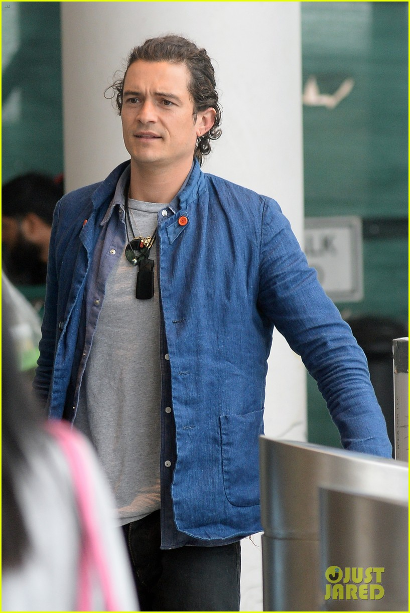 orlando bloom jets off after getting lap dance neil patrick harris 163131873