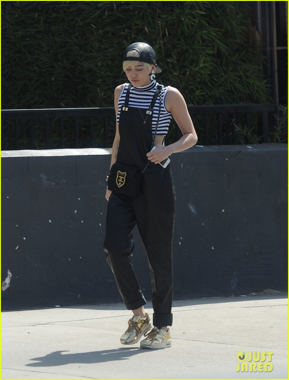miley cyrus goes shopping after arriving home from europe 033143352