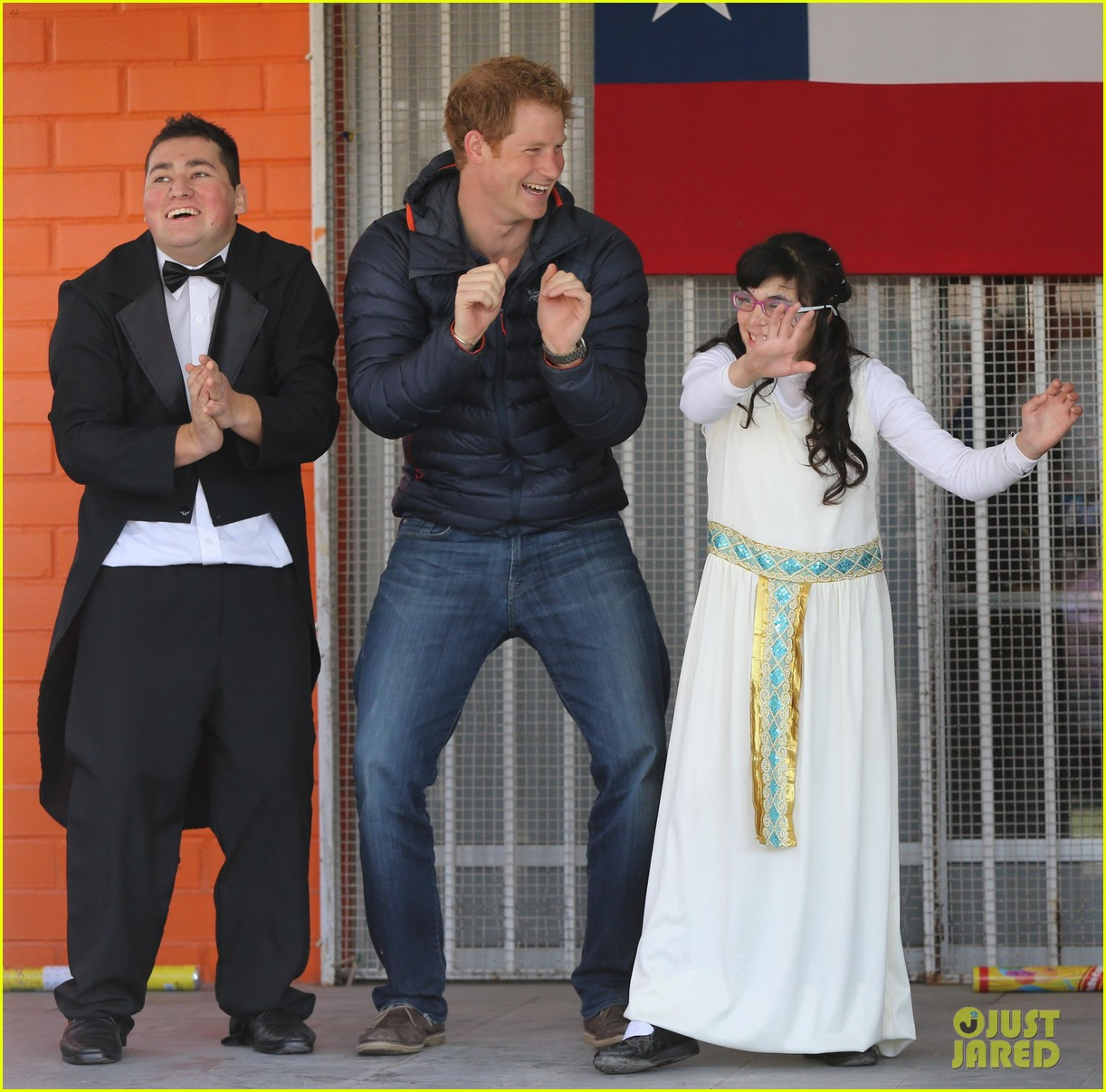 prince harry busts a move children chile visit 033146201