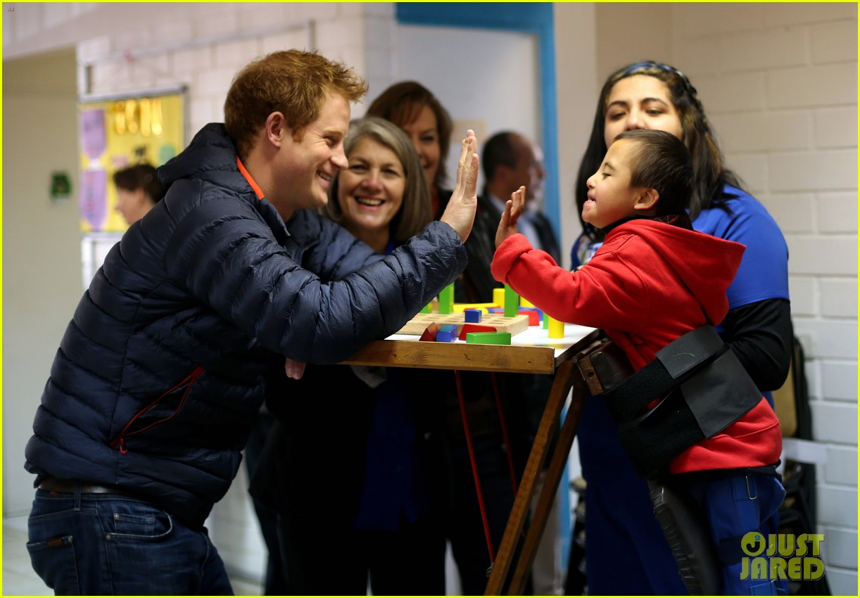 prince harry busts a move children chile visit 143146212