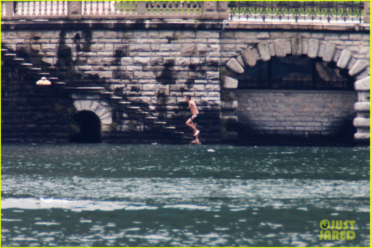 harry styles jumps into lake como 303146826