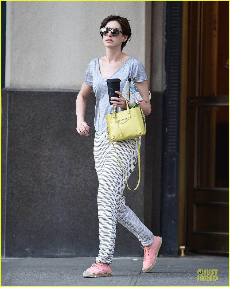 anne hathaway gets down to business with andrew rannells 013138746