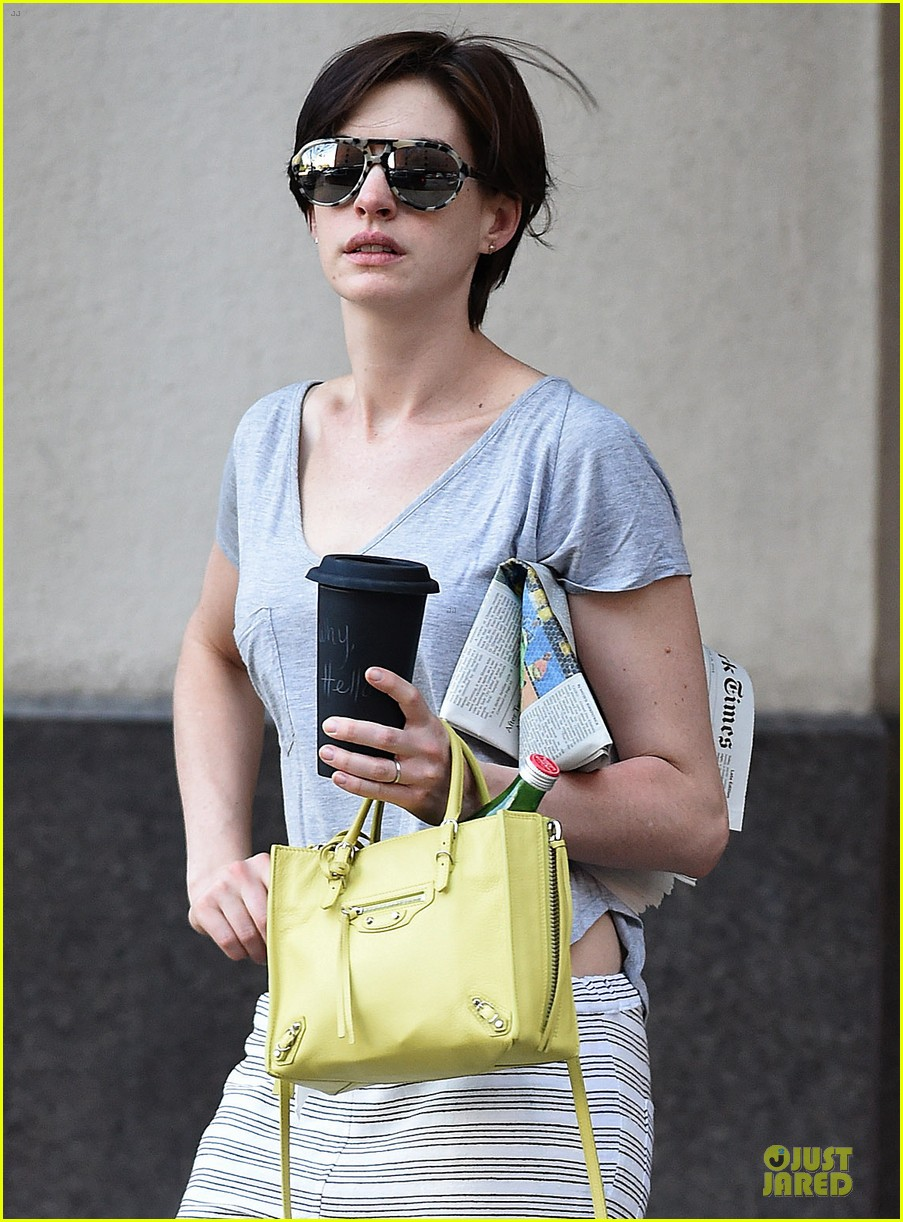 anne hathaway gets down to business with andrew rannells 023138747