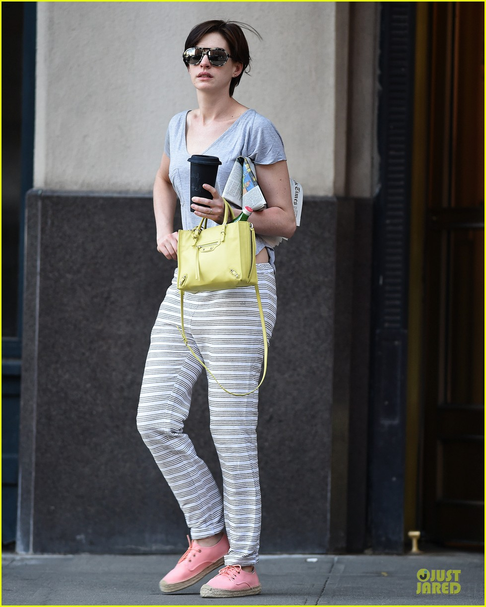 anne hathaway gets down to business with andrew rannells 033138748