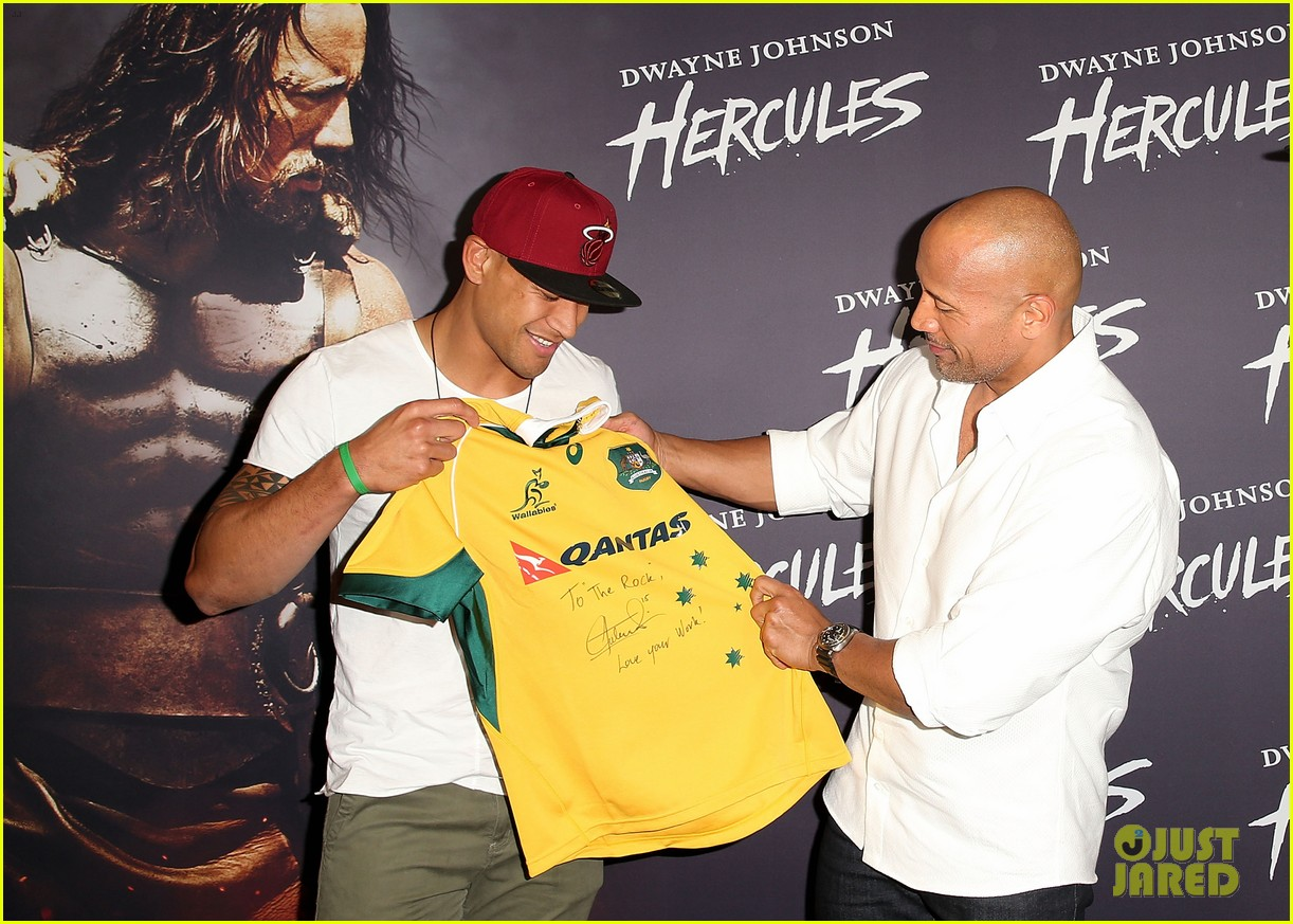 dwyane johnson presented with wallabies jersey at australian hercules screening 013138957