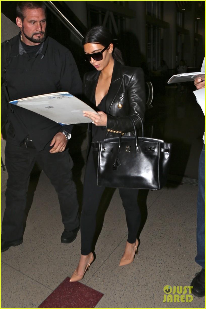 kim kardashian arrives at lax without new husband kanye west 023126202