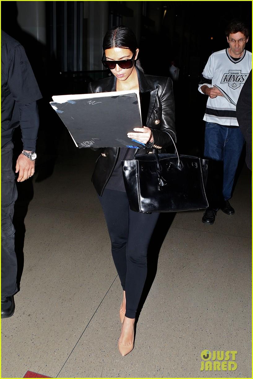 kim kardashian arrives at lax without new husband kanye west 053126205