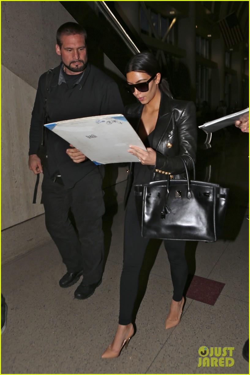 kim kardashian arrives at lax without new husband kanye west 093126209