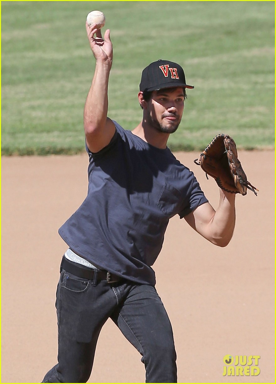 taylor lautner buff arms run the tide baseball pitch 023140533