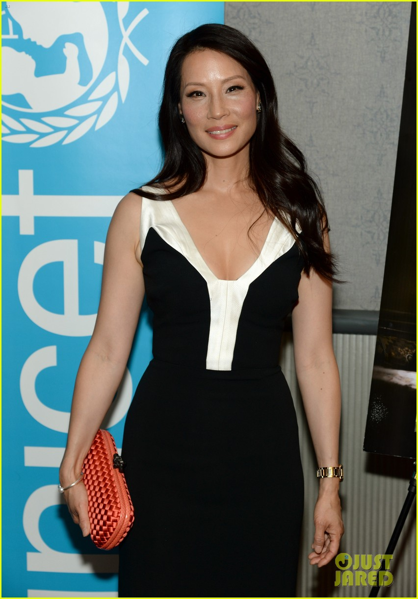 lucy liu gets support from carla gugino at her meena premiere 06