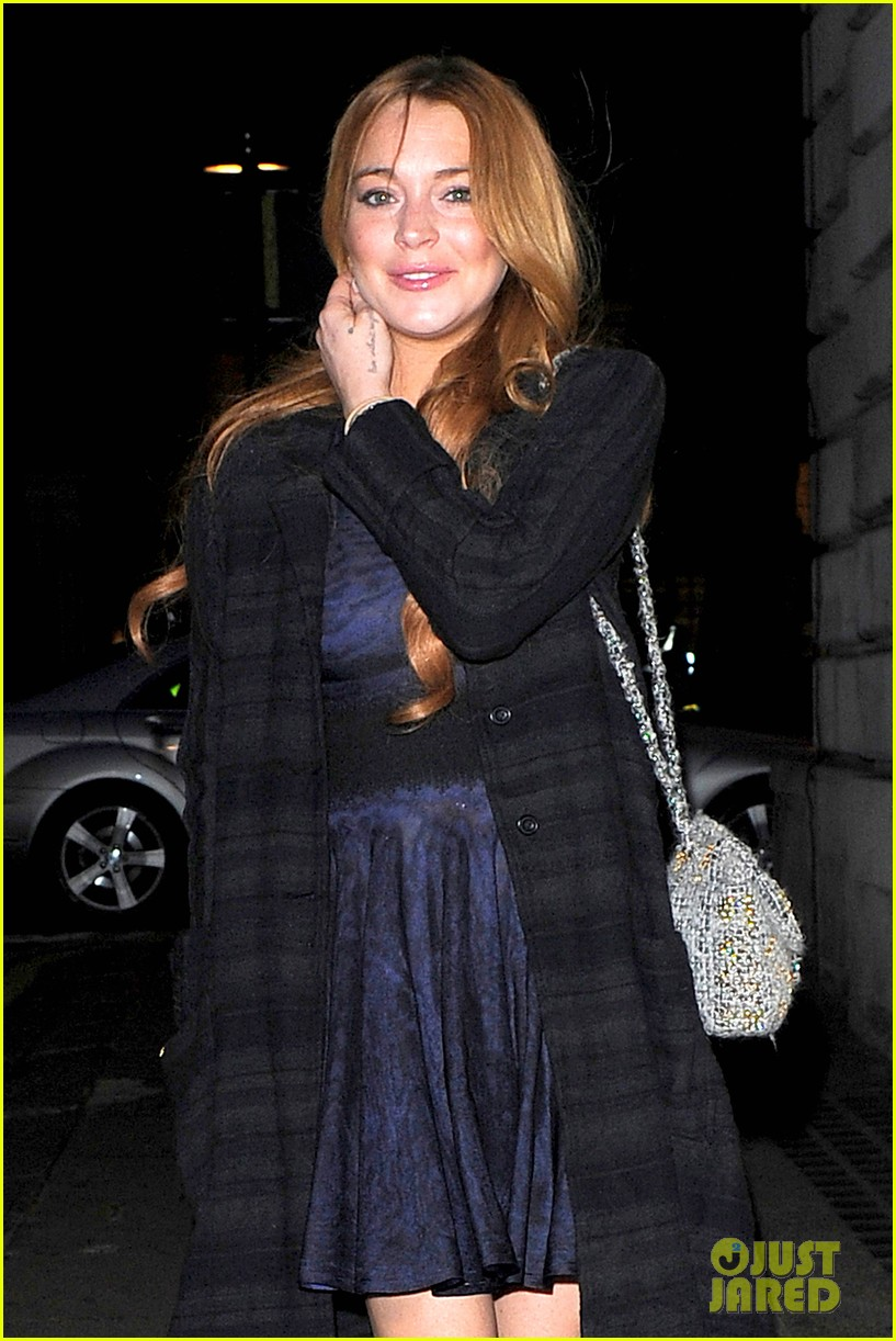 lindsay lohan changes up her look to evening wear for night out 123143026