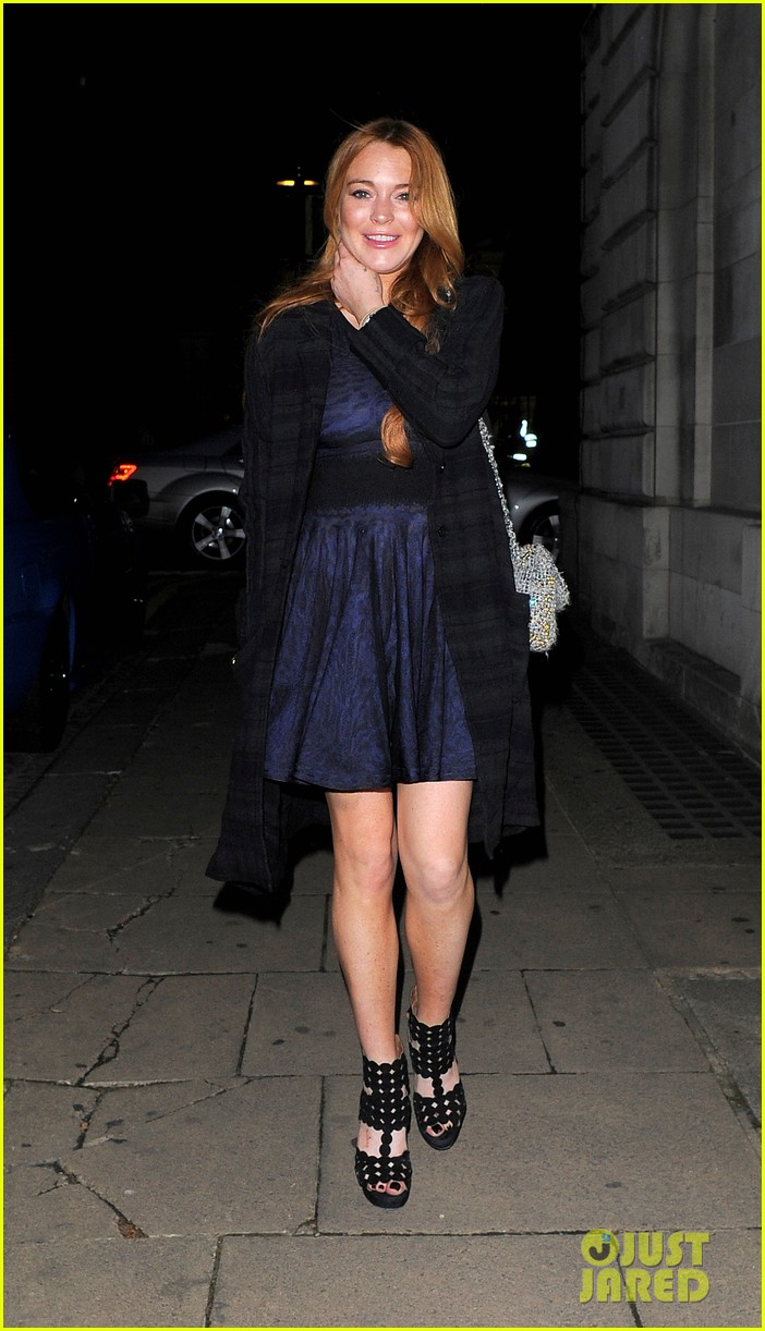 lindsay lohan changes up her look to evening wear for night out 133143027