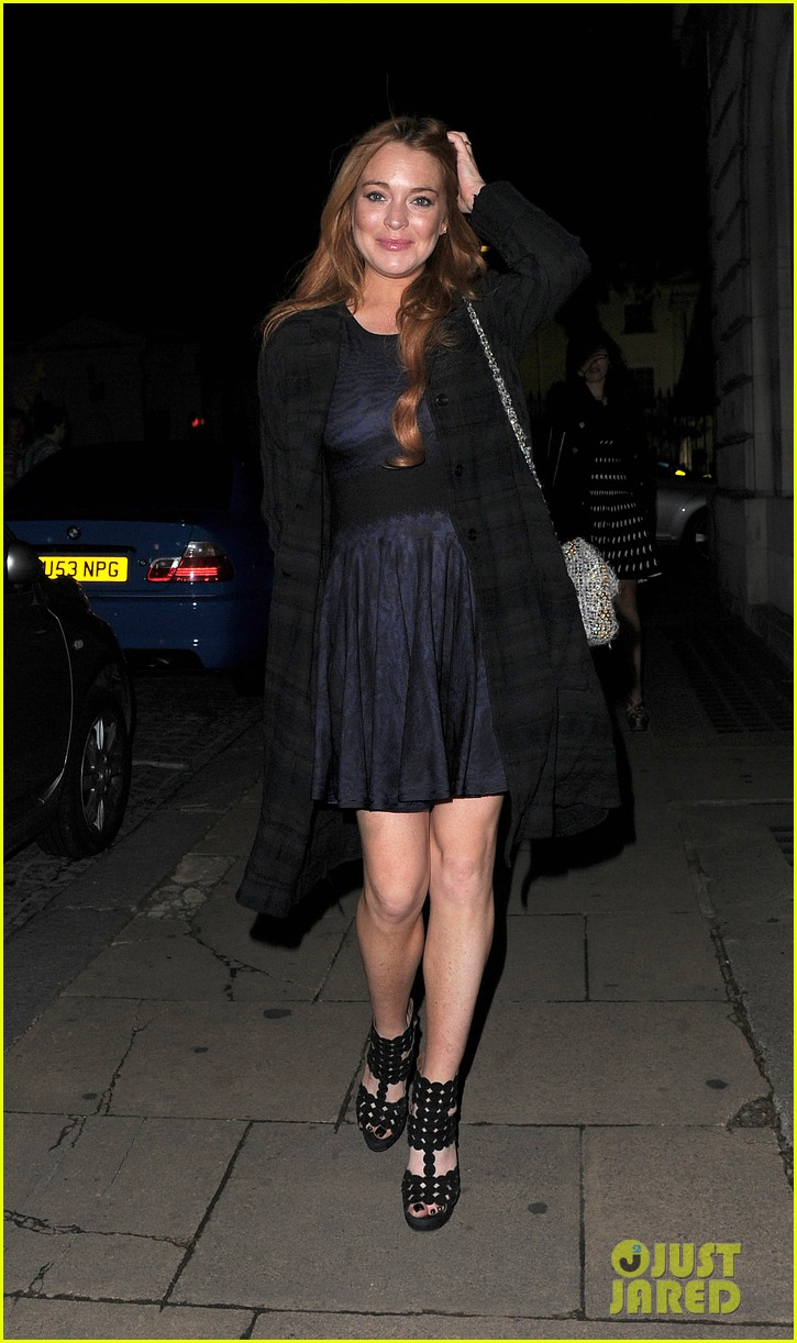 lindsay lohan changes up her look to evening wear for night out 203143034