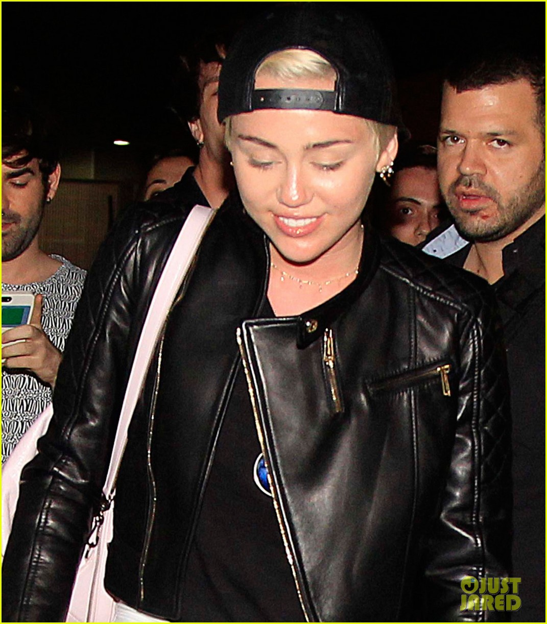 miley cyrus jets barcelona after topless photos 013135923