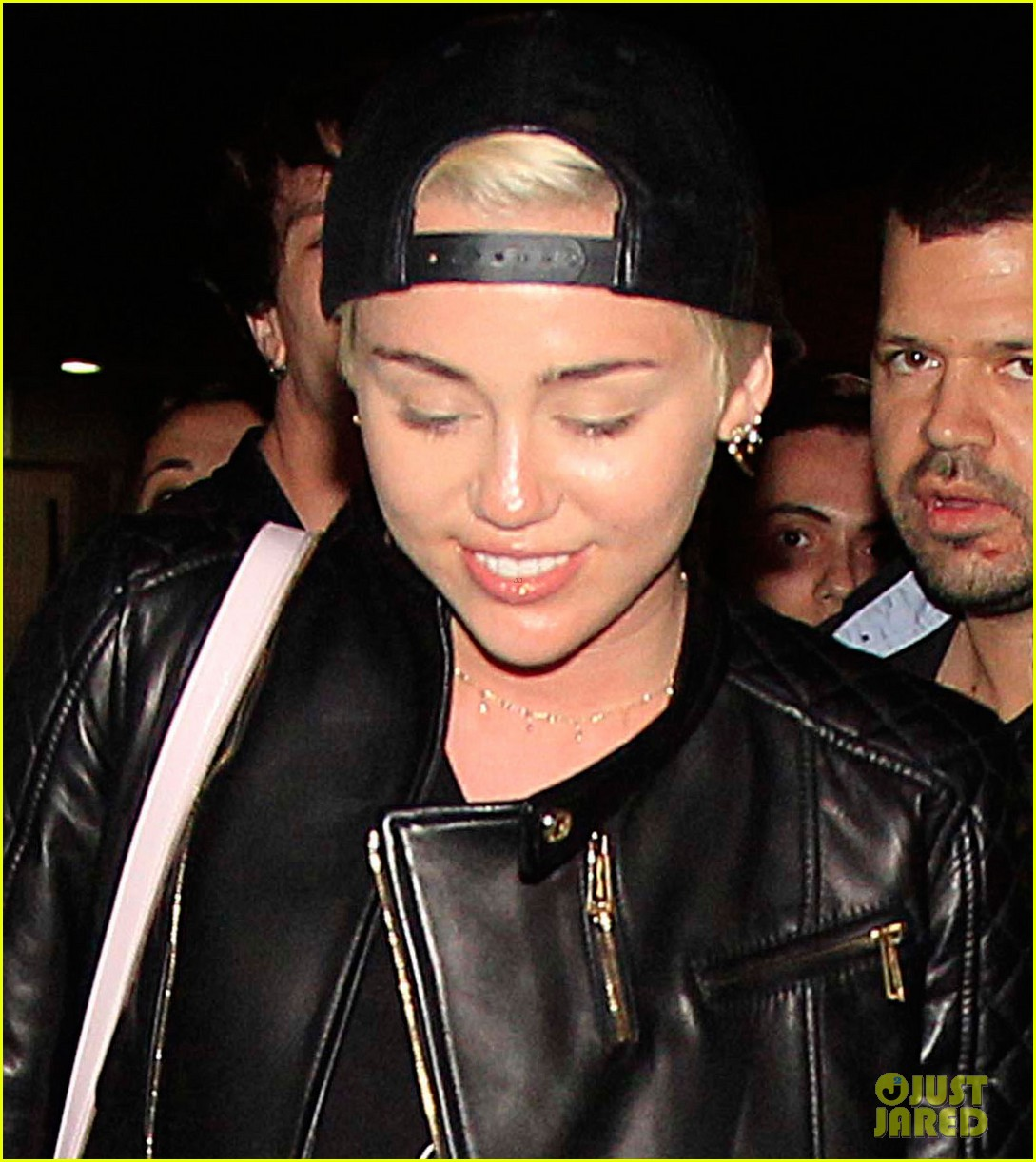 miley cyrus jets barcelona after topless photos 053135927